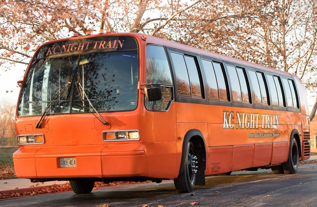 Orange Party Bus (Exterior, Front, Driver's Side)