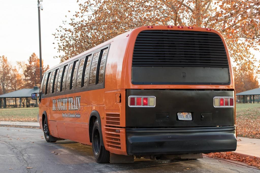 Orange Party Bus (Exterior, Rear, Driver's Side)